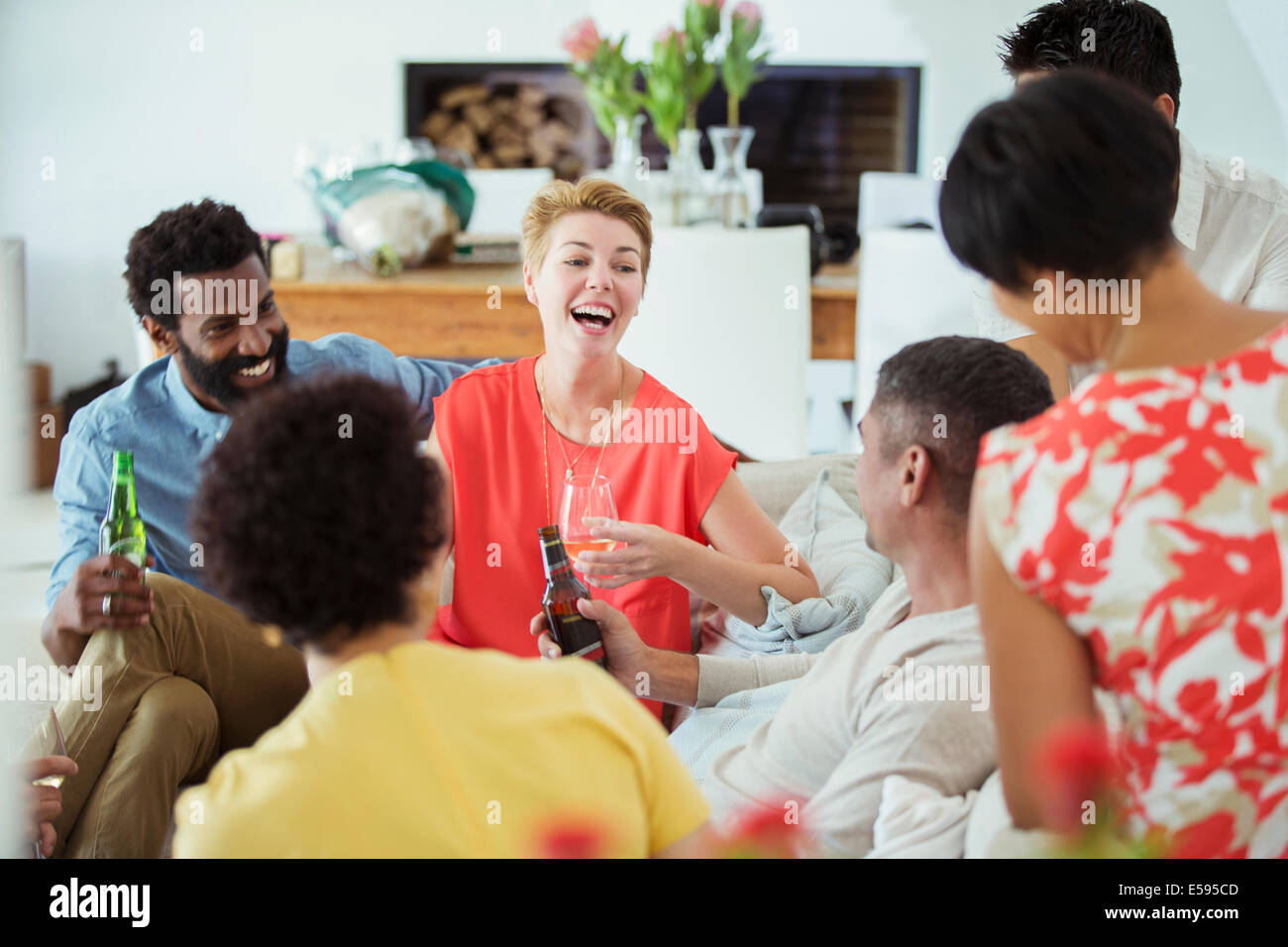 Friends relaxing at party - Stock Image