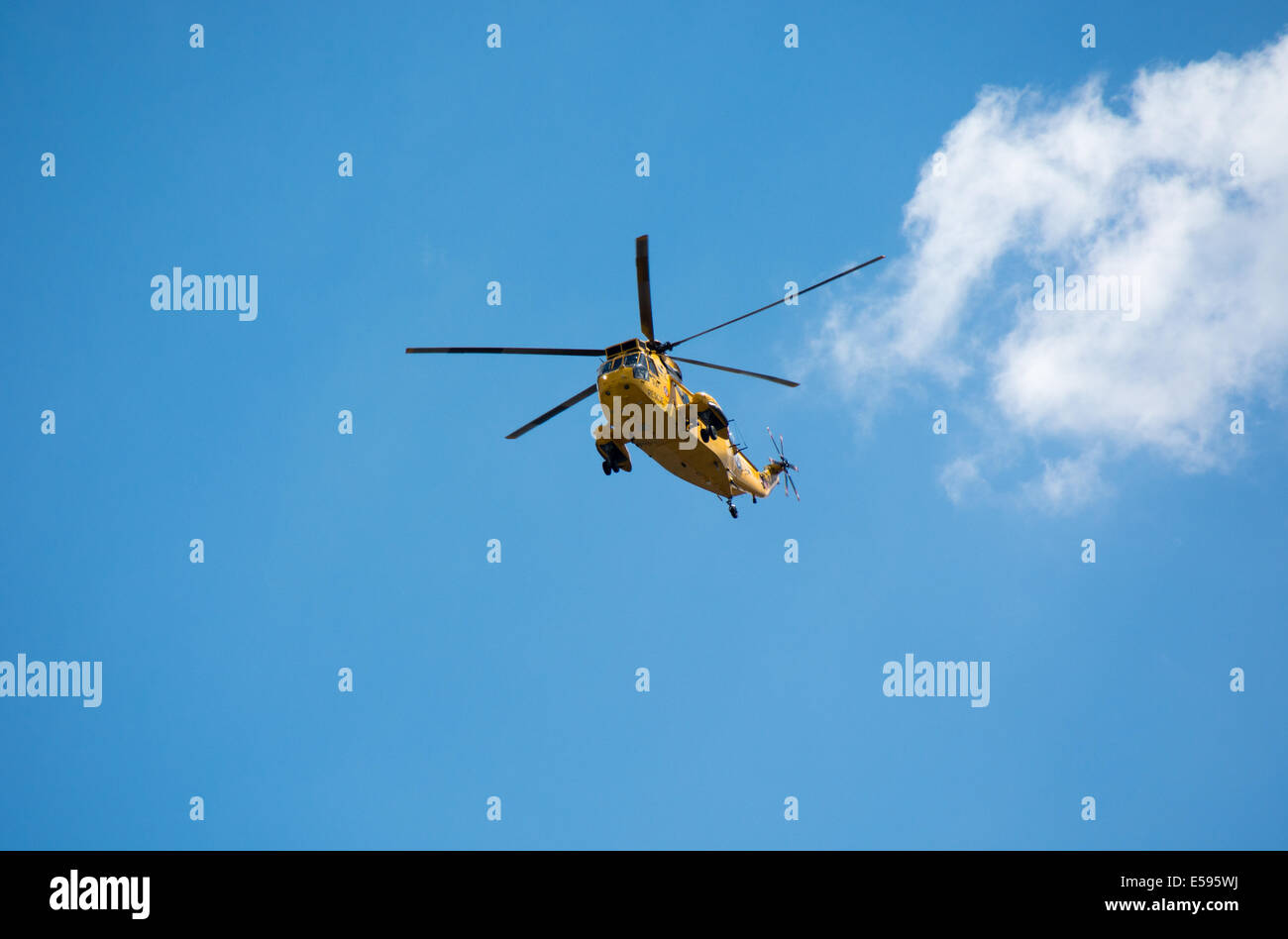 A Royal Air Force Sea King search and rescue (SAR) helicopter flies above the River Thames in London. - Stock Image