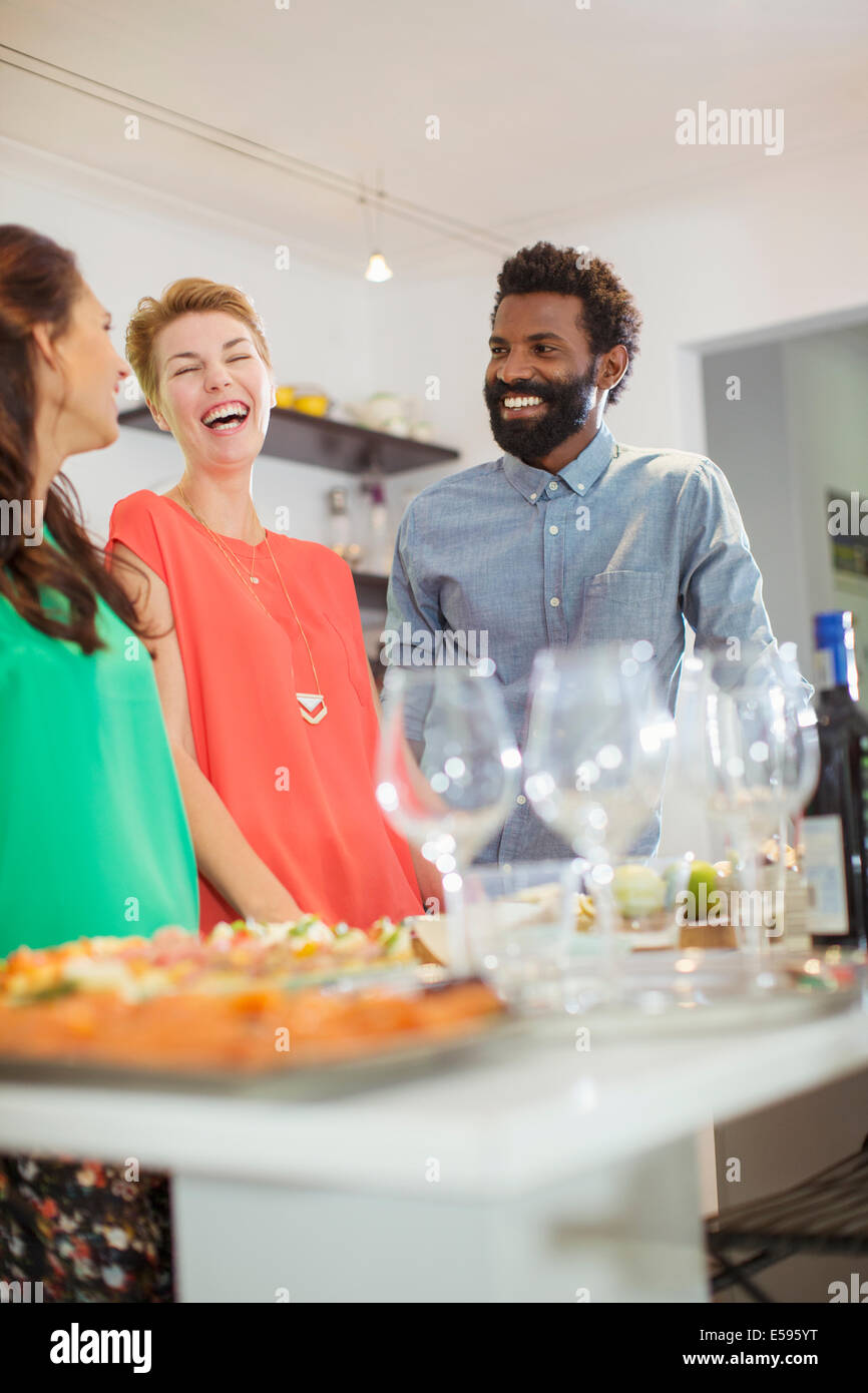Friends laughing at party - Stock Image