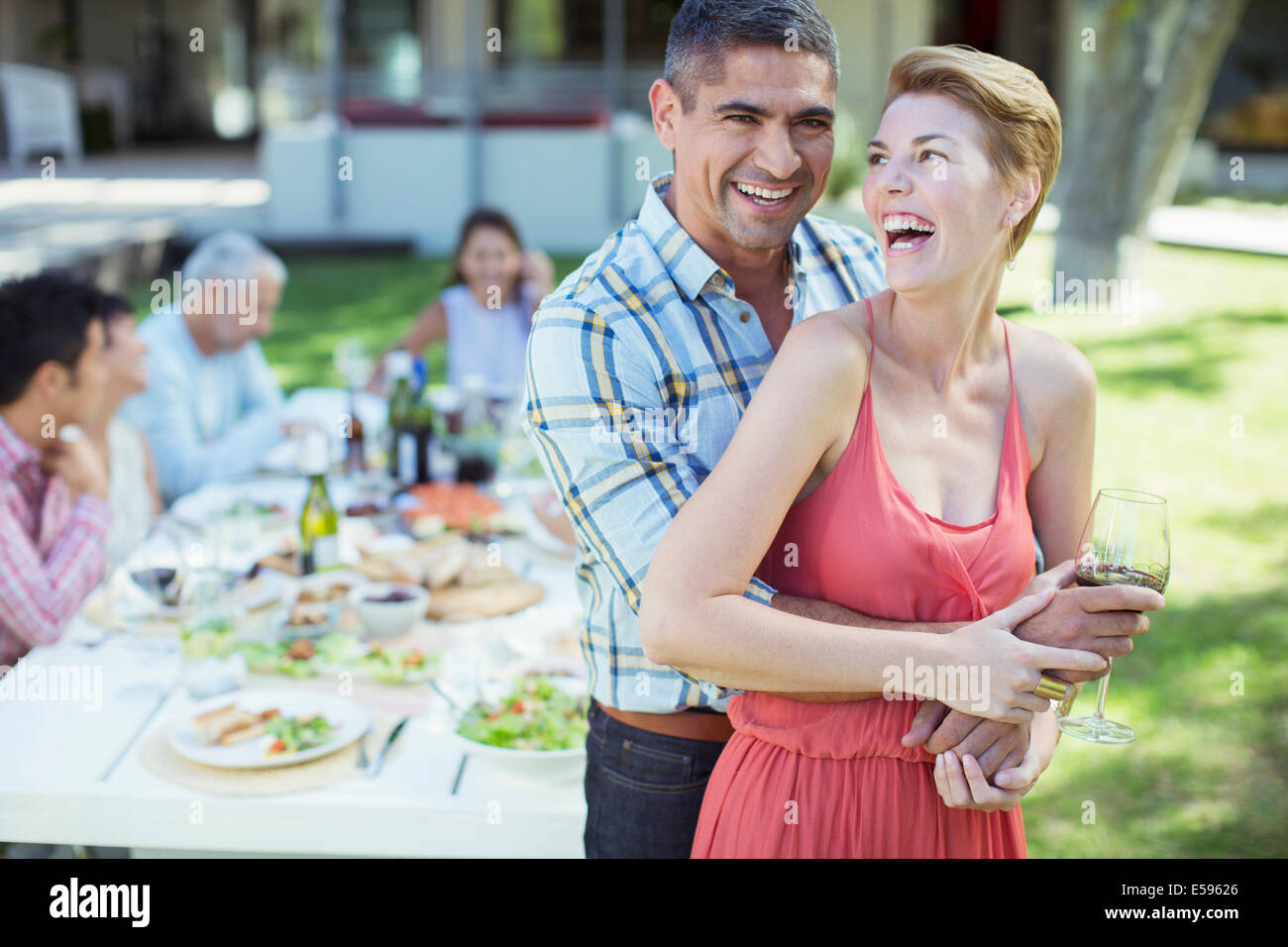 Laughing couple hugging outdoors Stock Photo