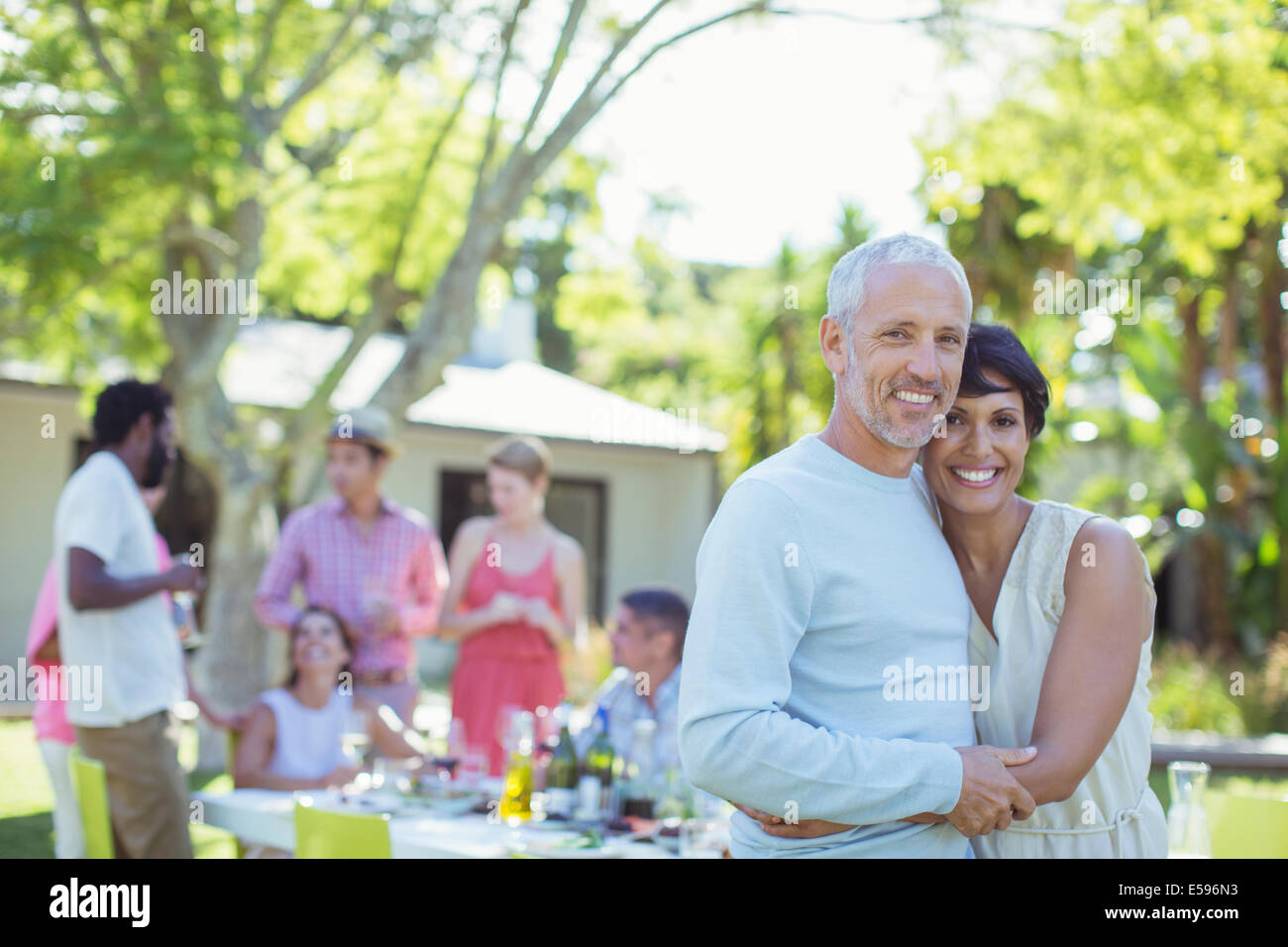 Couple hugging at party - Stock Image