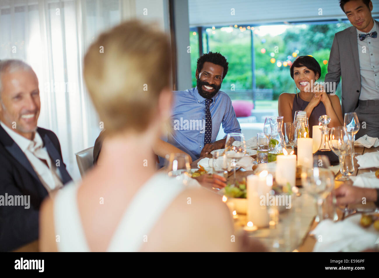 Friends talking at dinner party - Stock Image