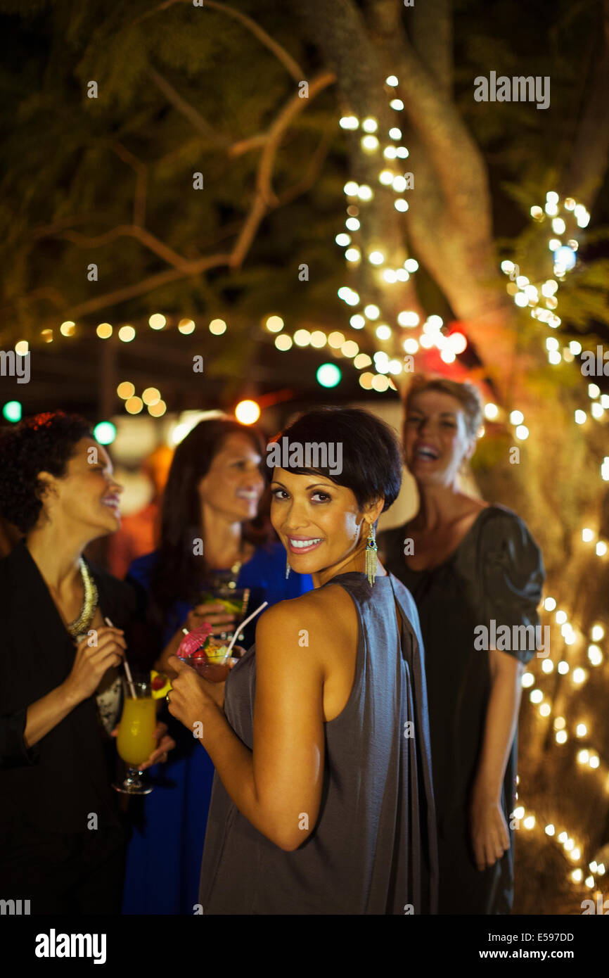Woman smiling at party - Stock Image