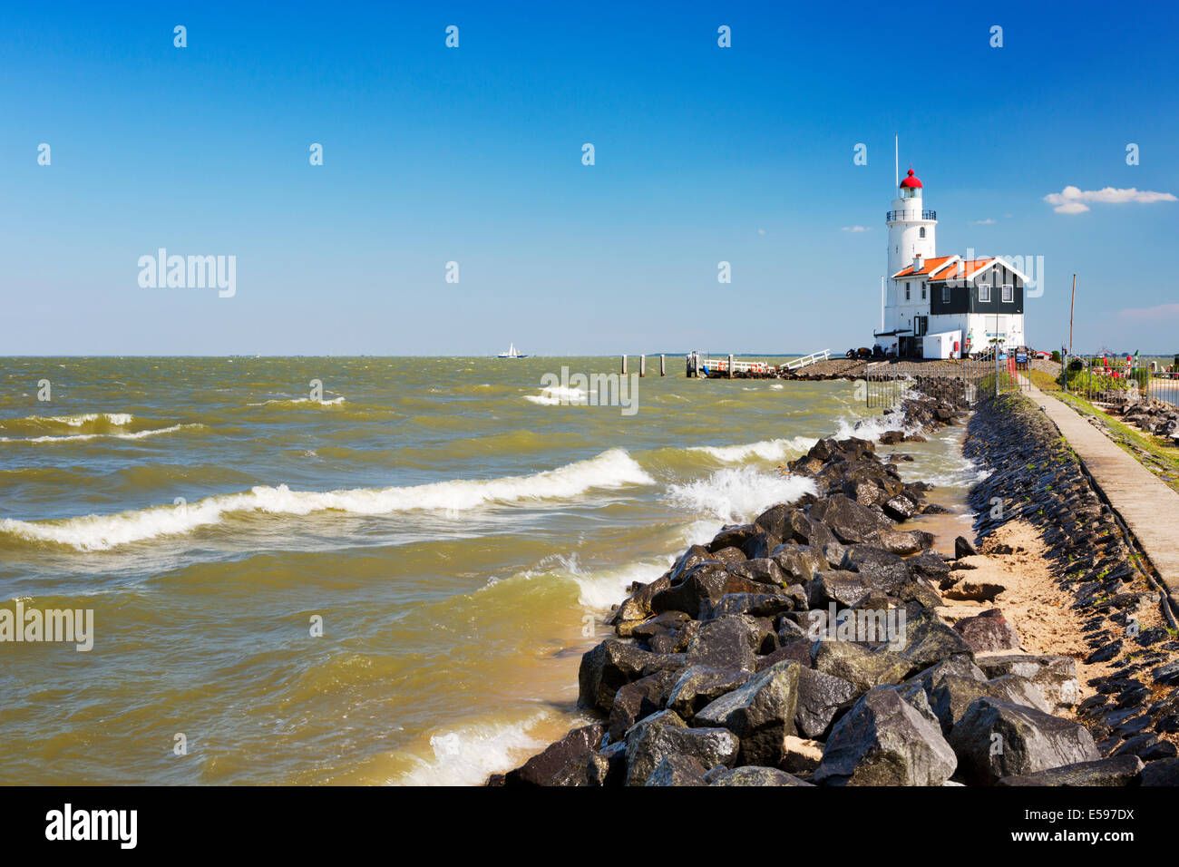 The lighthouse of the island of Marken in The Netherlands - Stock Image