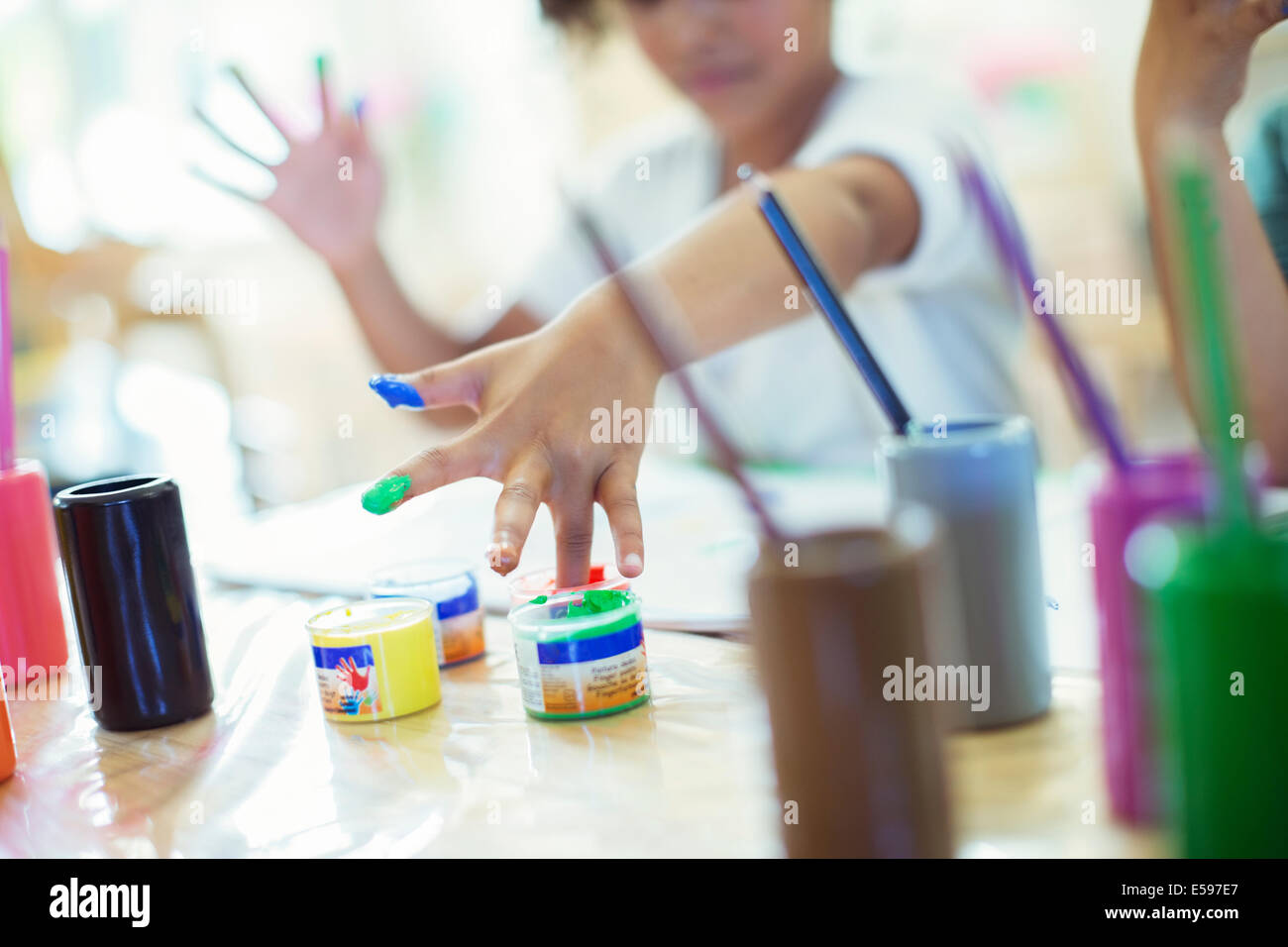 Student finger painting in class - Stock Image