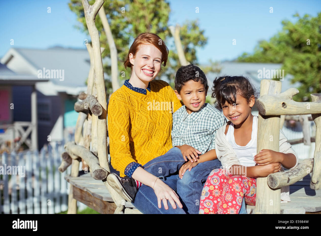Students and teacher sitting outdoors - Stock Image