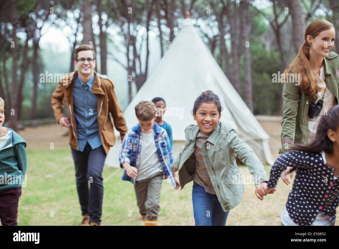 Teachers and students walking in forest - Stock Image