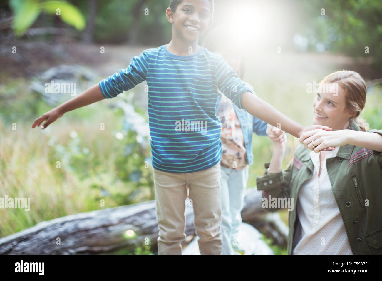 Teacher and student playing in forest - Stock Image