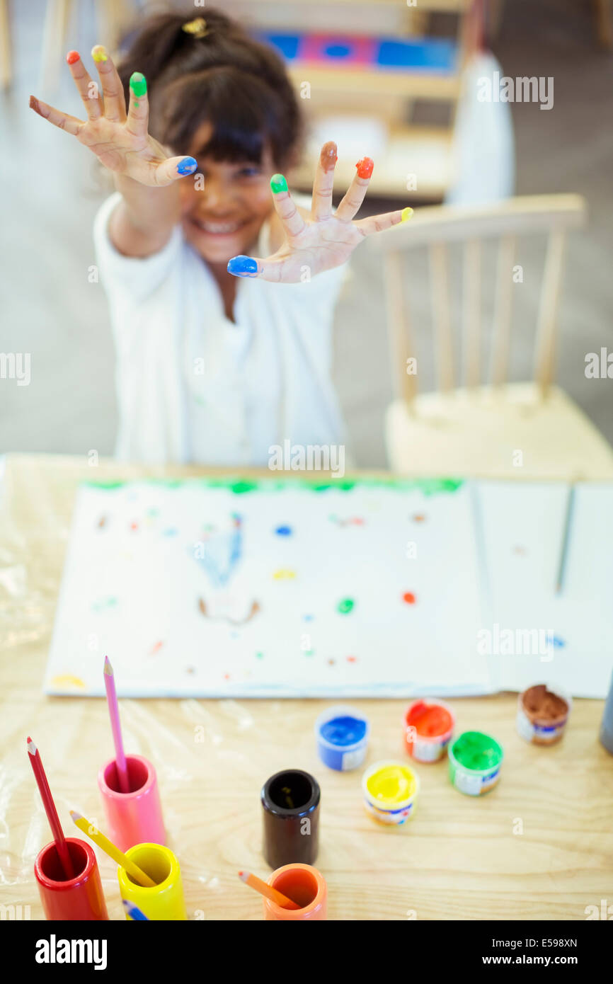 Student finger painting in classroom Stock Photo