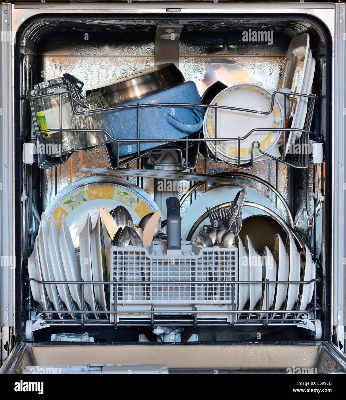 Open the front door of the dishwasher full of clean dishes Stock ...