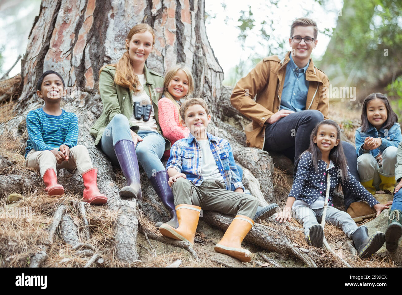 Students and teachers smiling in forest Stock Photo