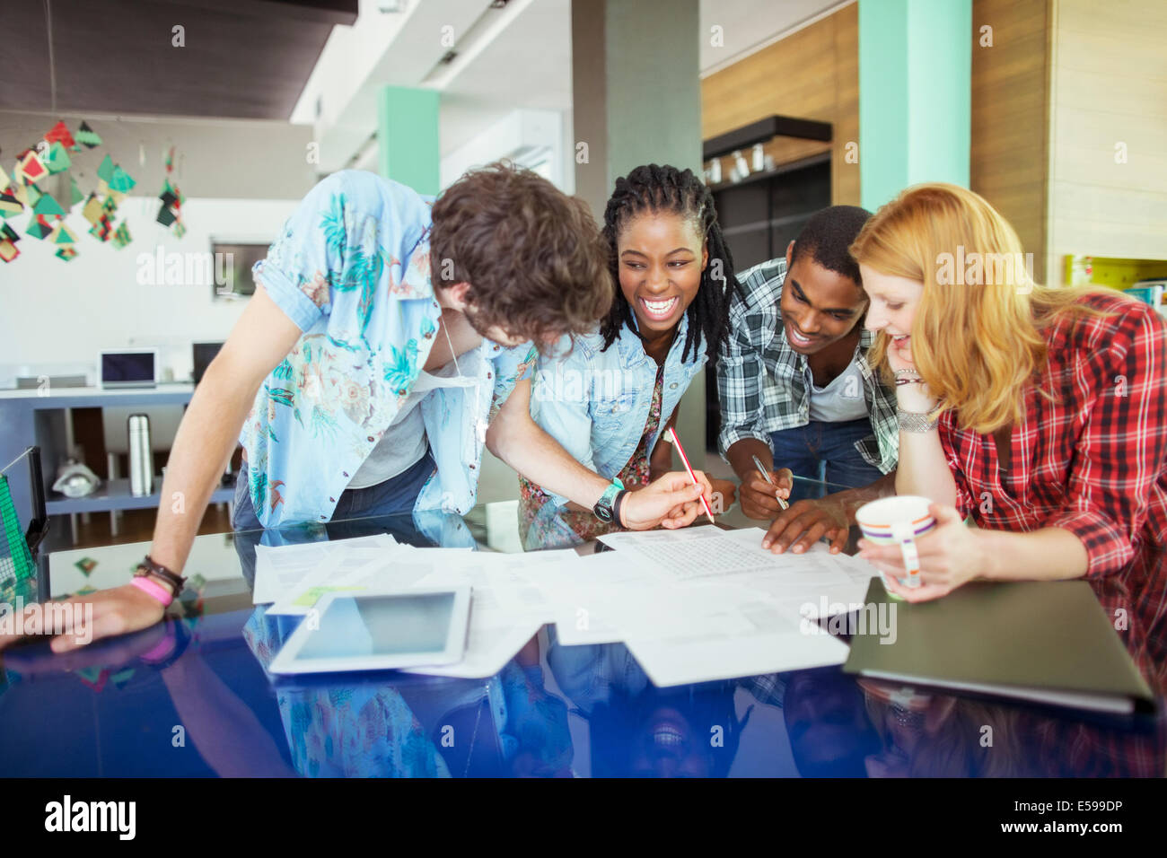People working together in cafe - Stock Image