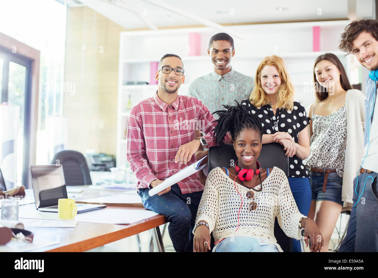 People smiling together in office - Stock Image