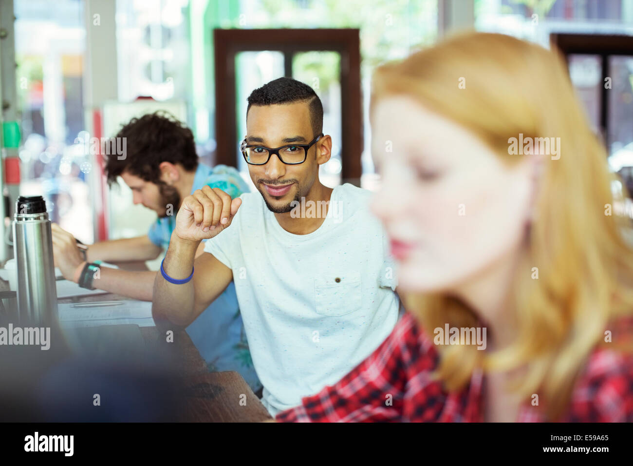 Man working in cafe - Stock Image