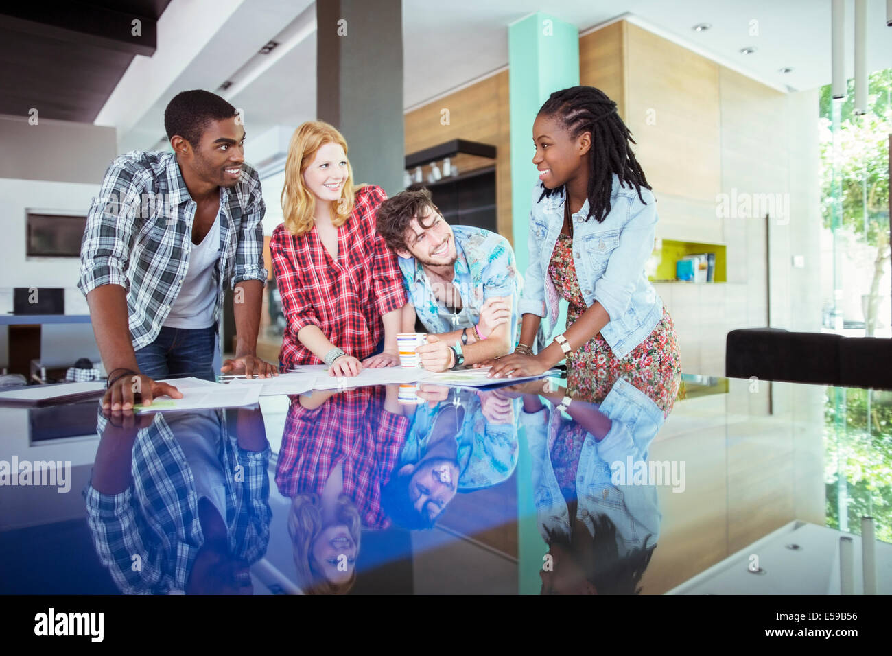 People working together at conference table in office Stock Photo
