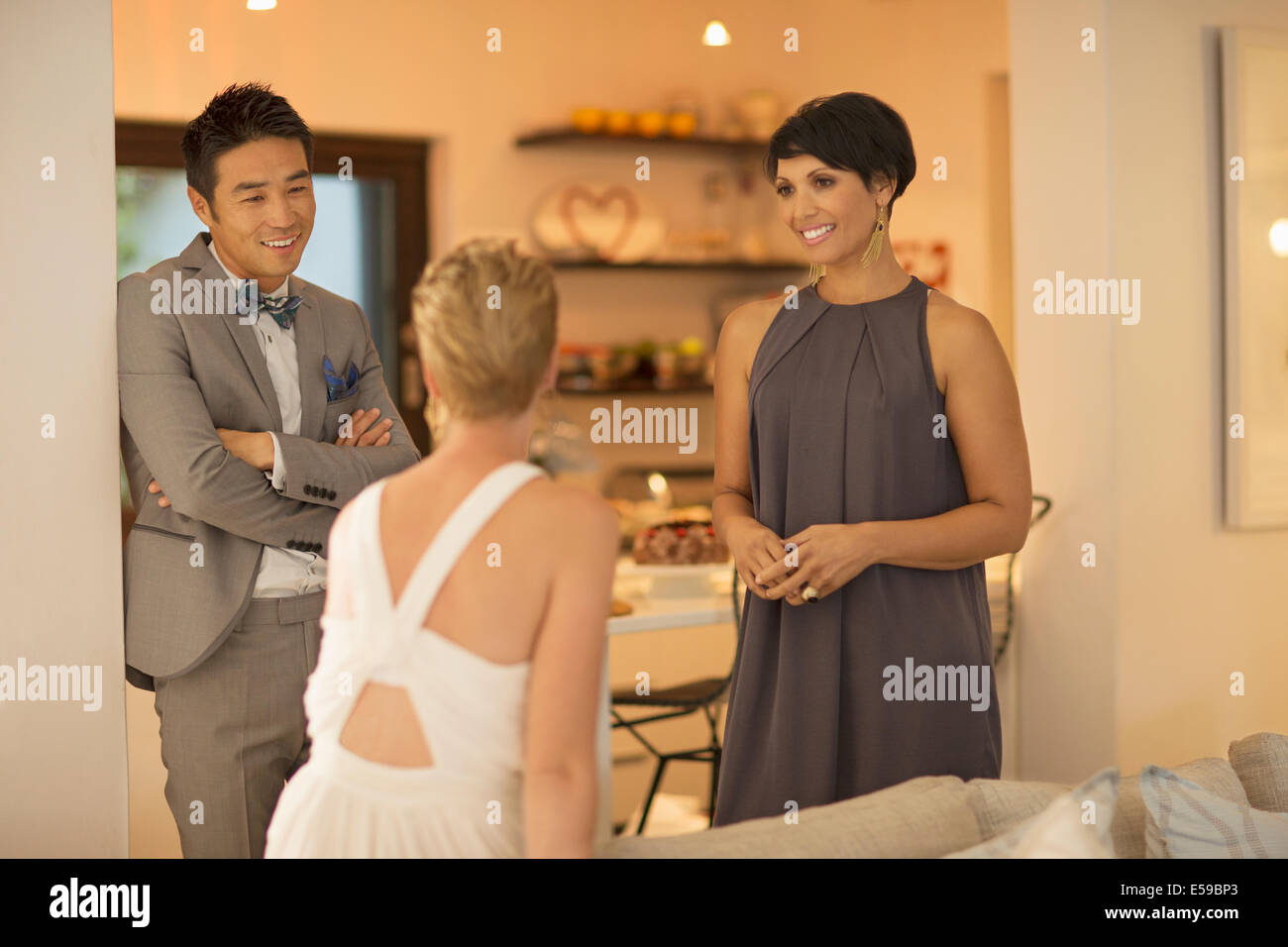 Friends talking at party - Stock Image