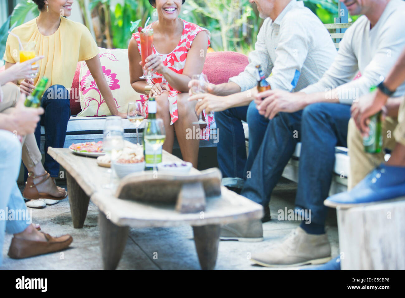 Friends relaxing together at party - Stock Image