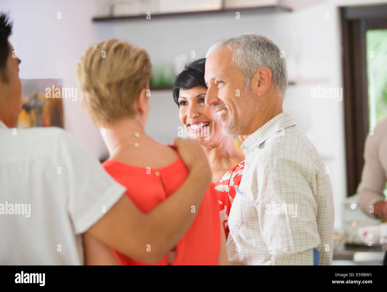 Friends talking at party Stock Photo