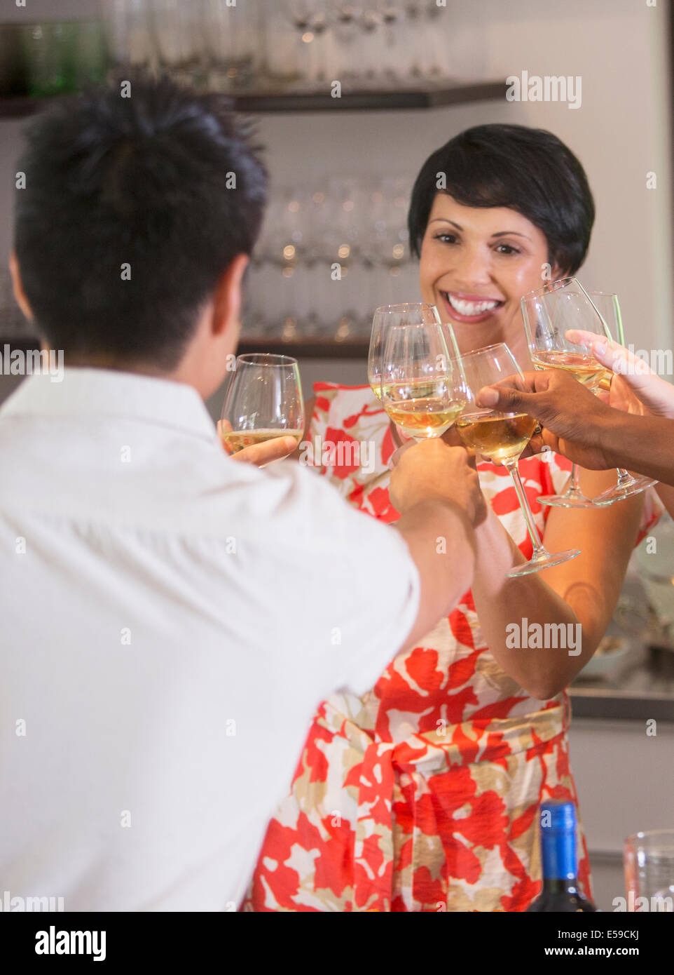 Friends toasting each other at party Stock Photo