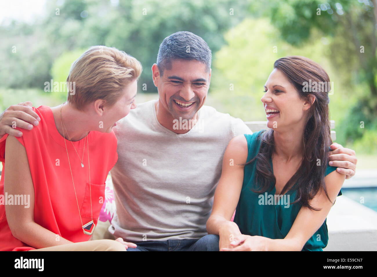 Friends relaxing together outdoors - Stock Image