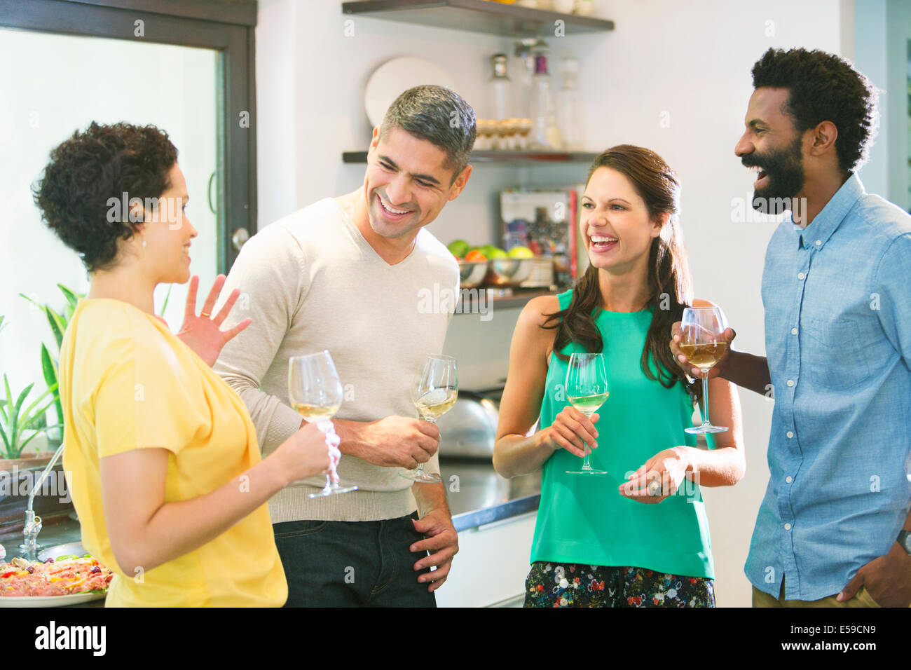Couples talking at party - Stock Image