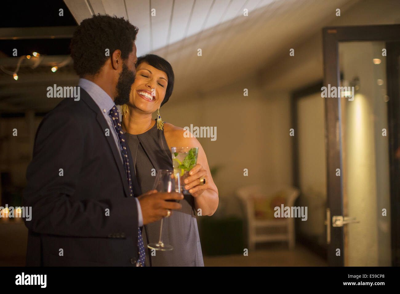 Couple kissing at party - Stock Image