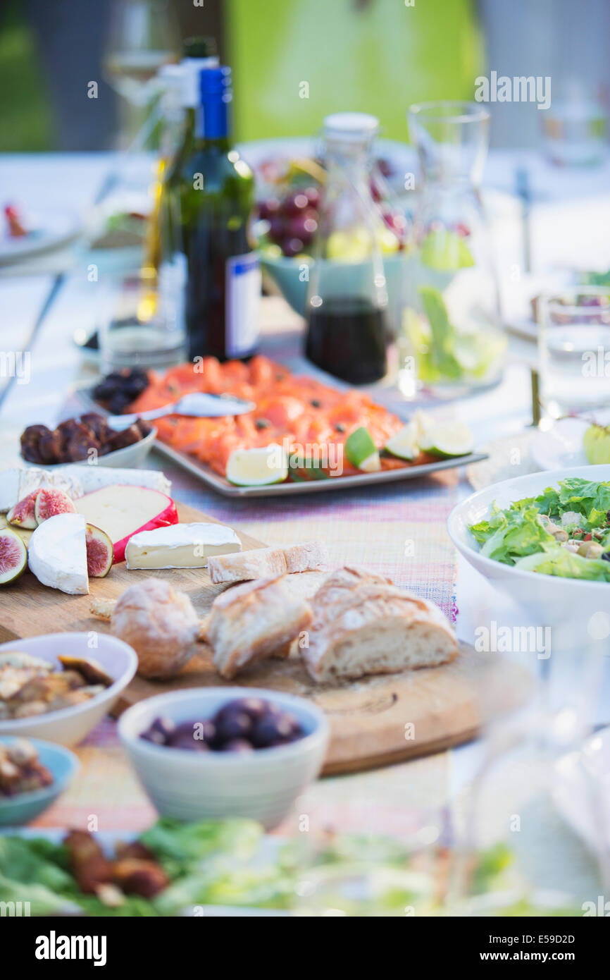 Plates of food on table outdoors Stock Photo