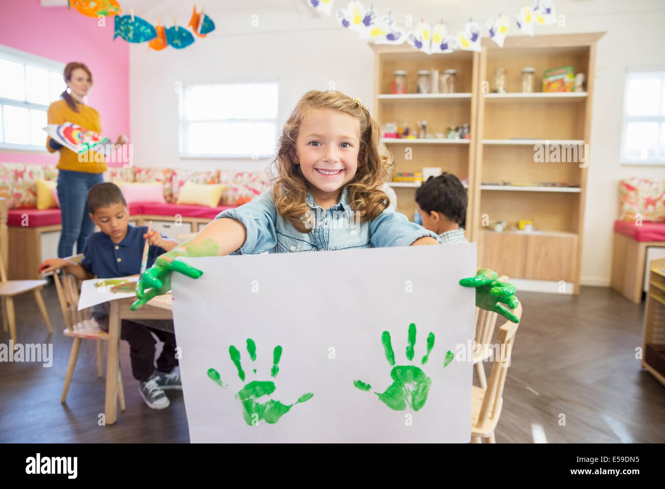 Student holding finger painting in class Stock Photo