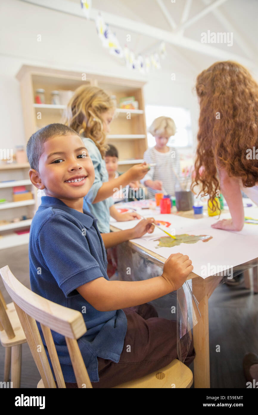 Student painting in classroom - Stock Image