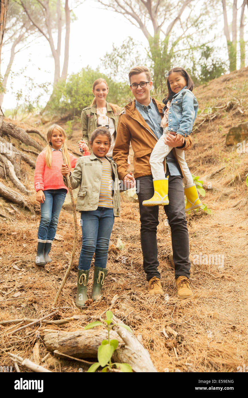 Students and teachers smiling in forest - Stock Image