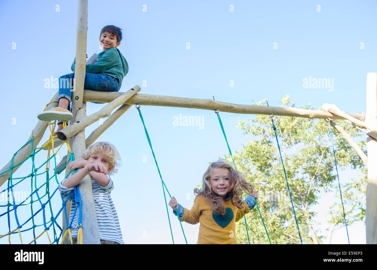 Children playing on play structure Stock Photo