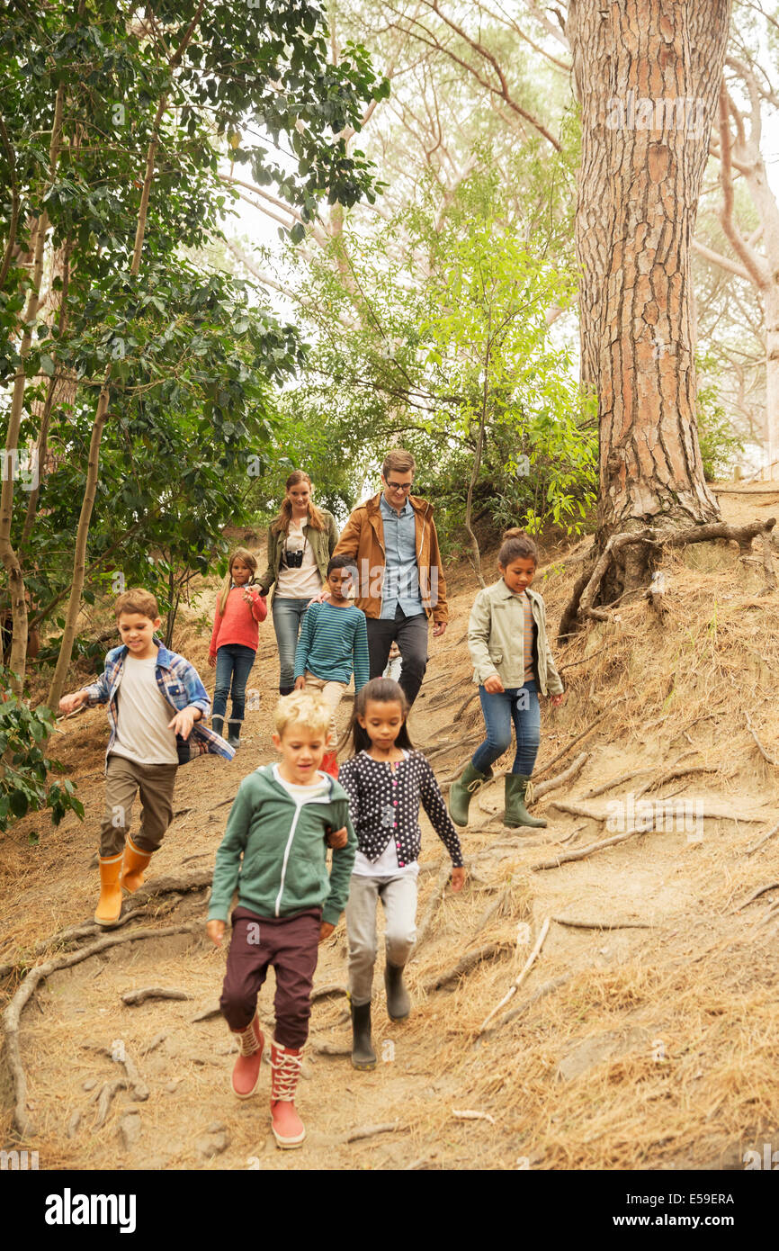 Students and teachers walking in forest - Stock Image