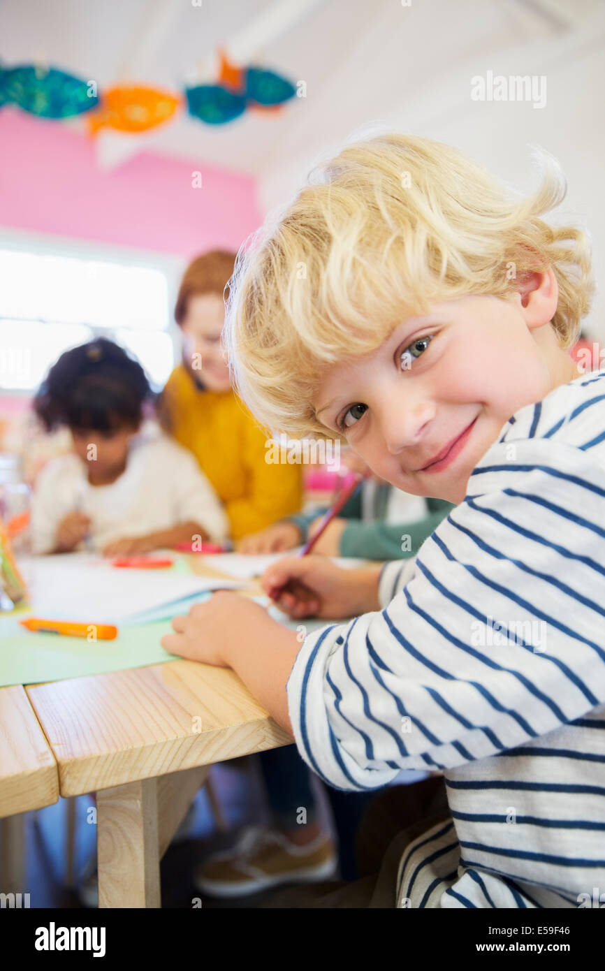 Student drawing in classroom Stock Photo