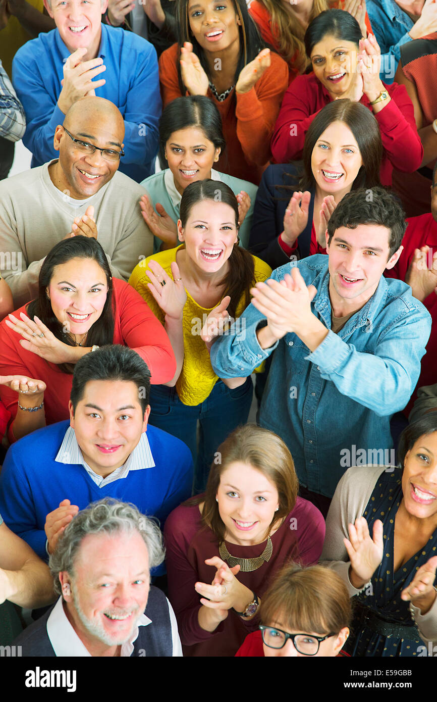 Portrait of happy crowd clapping - Stock Image