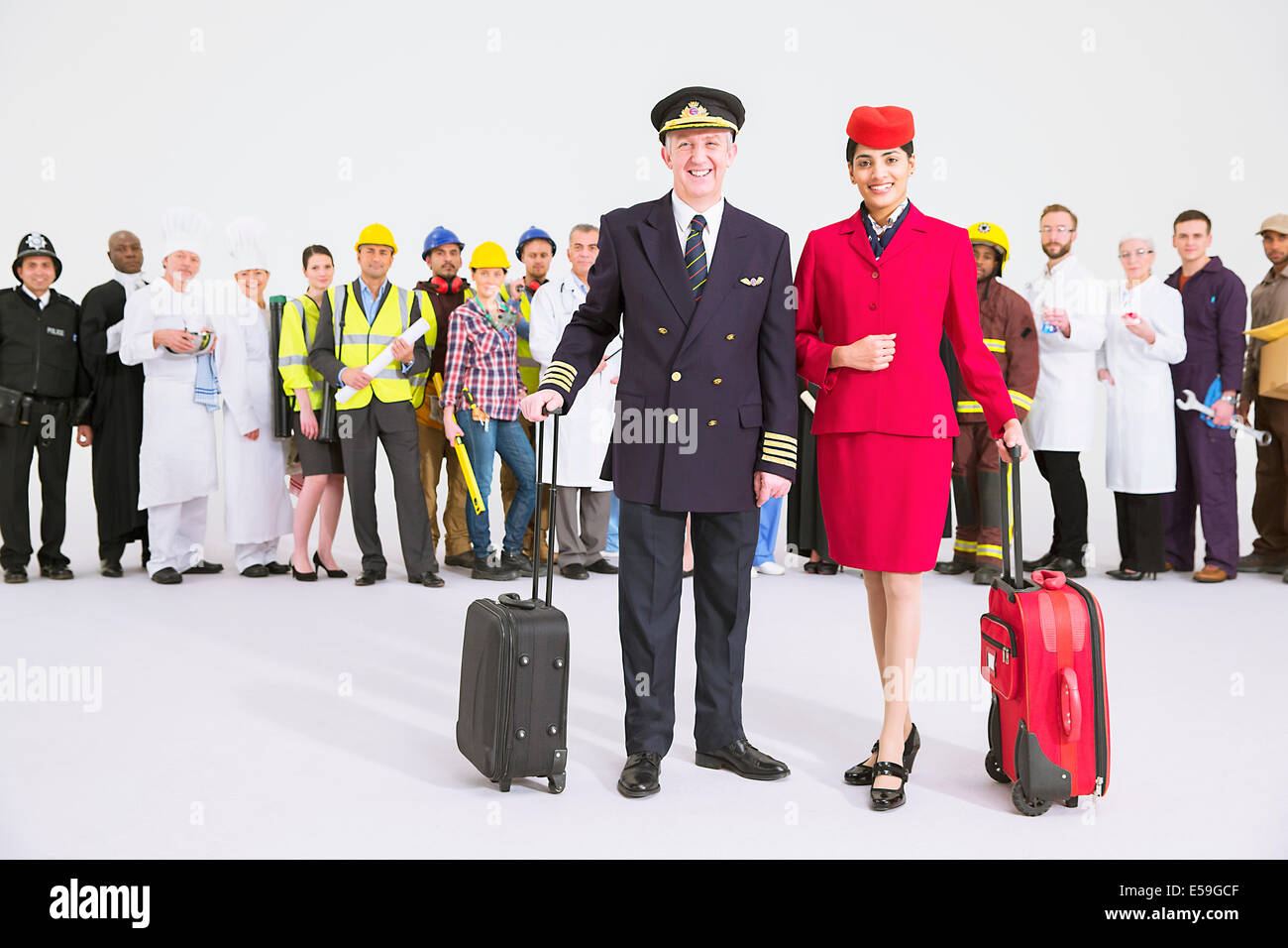 Portrait of confident pilot and flight attendant - Stock Image