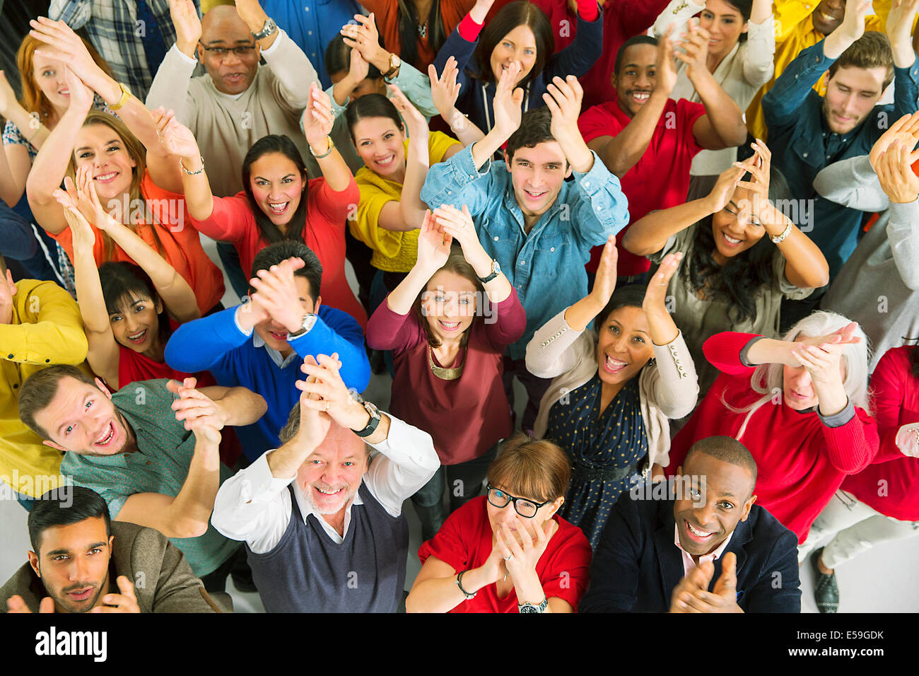 Portrait of diverse crowd clapping - Stock Image
