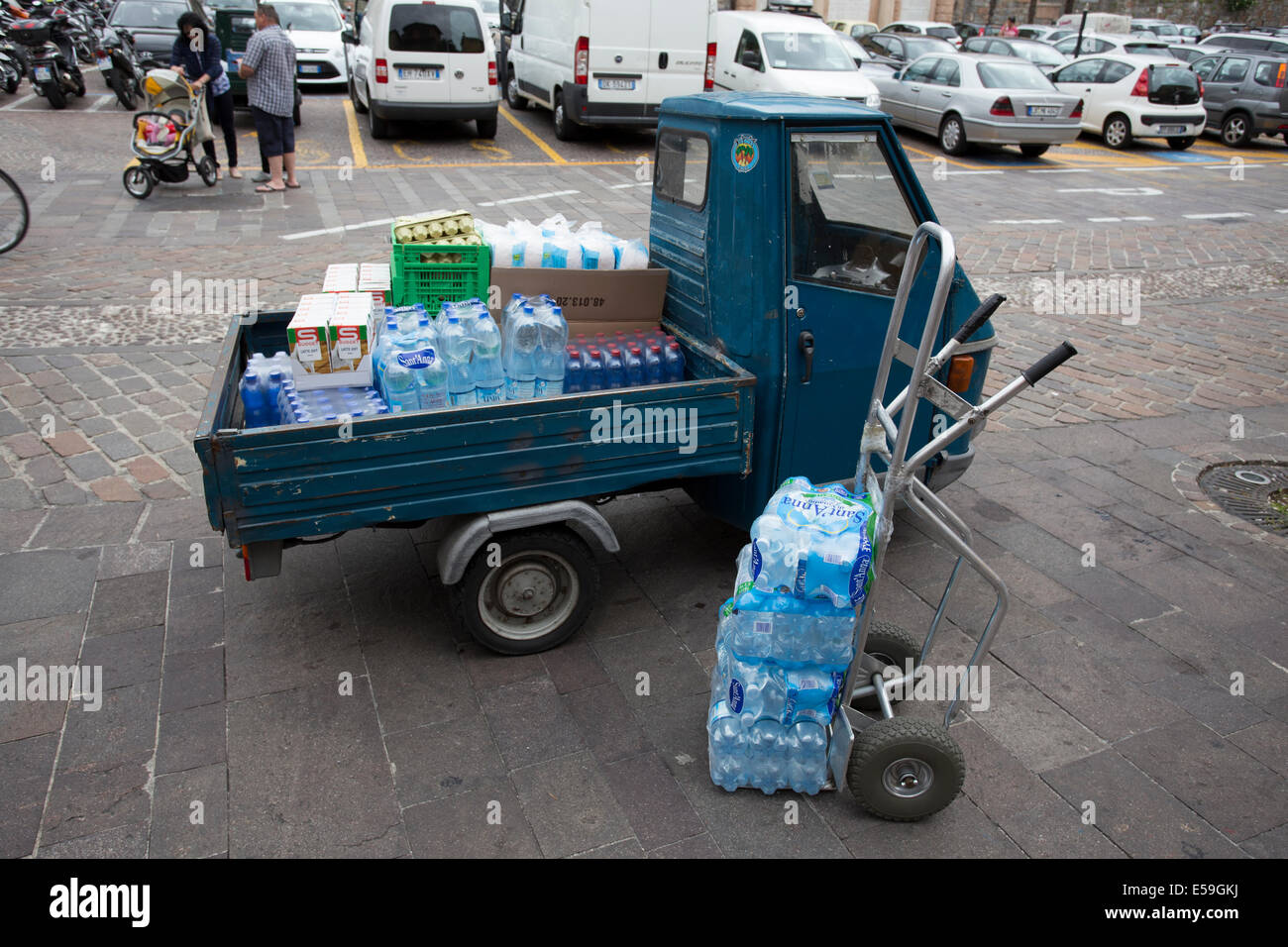 Three wheel truck delivers water in Malcesine, Italy - Stock Image