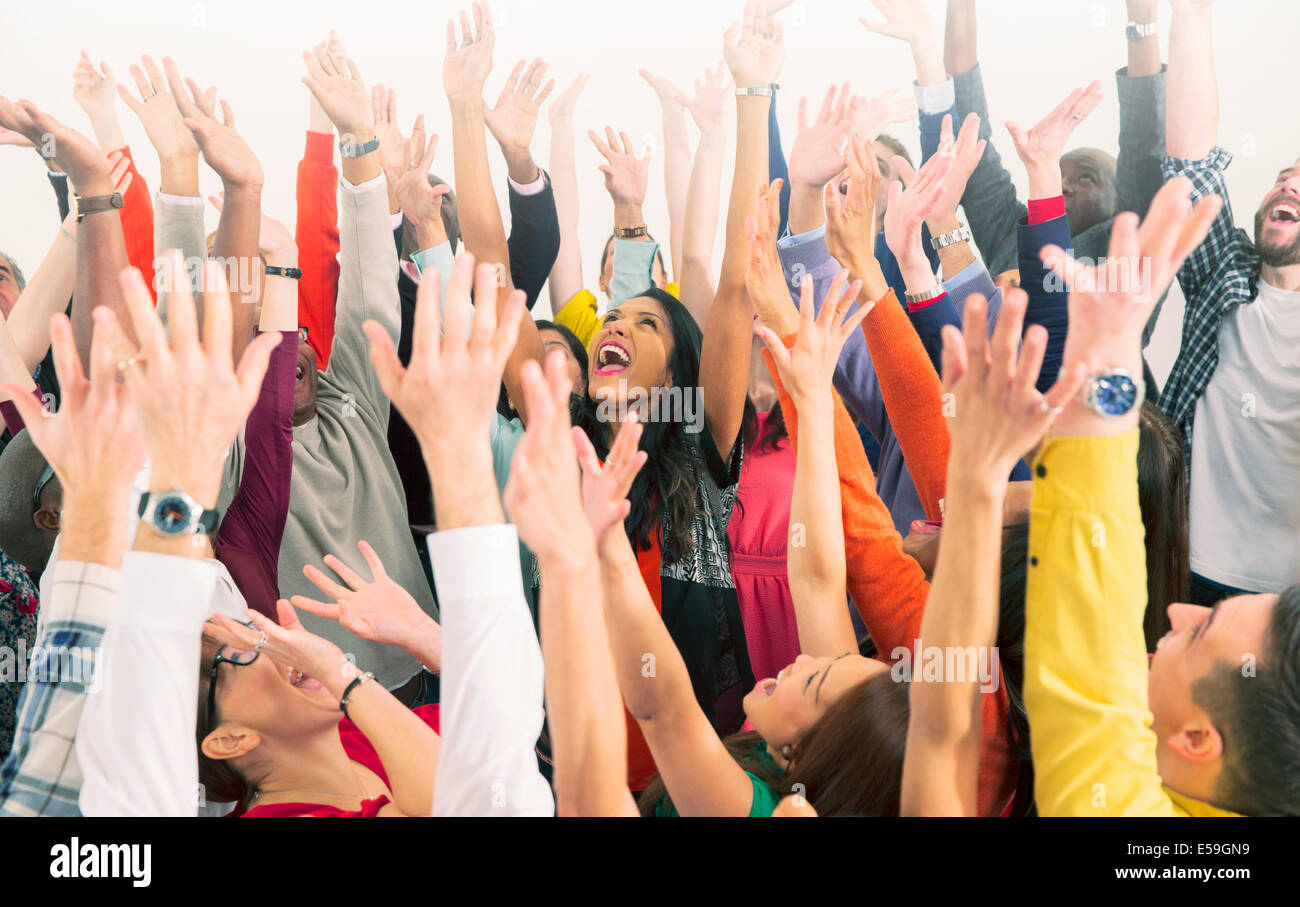 Enthusiastic crowd cheering - Stock Image