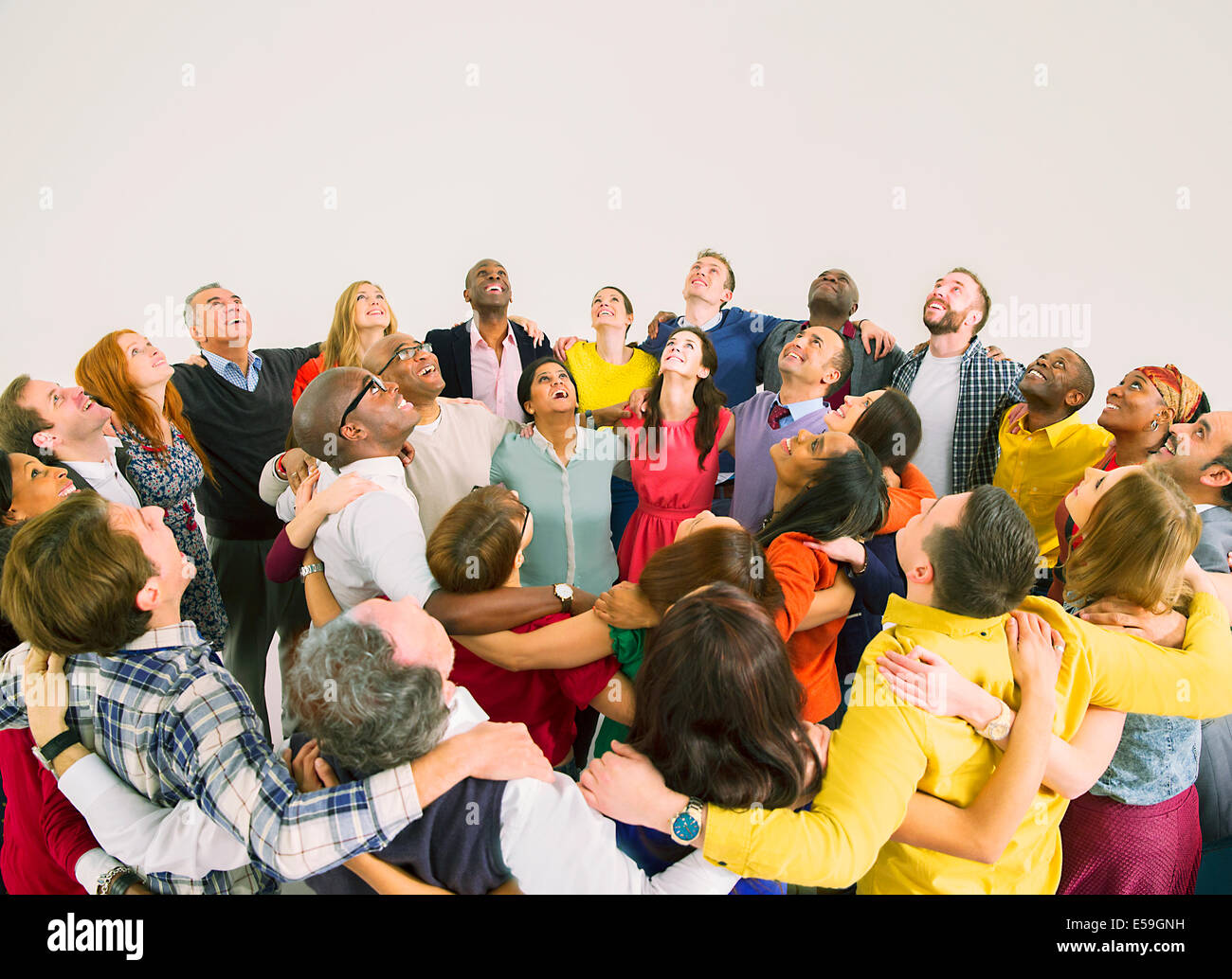 Diverse crowd in huddle - Stock Image
