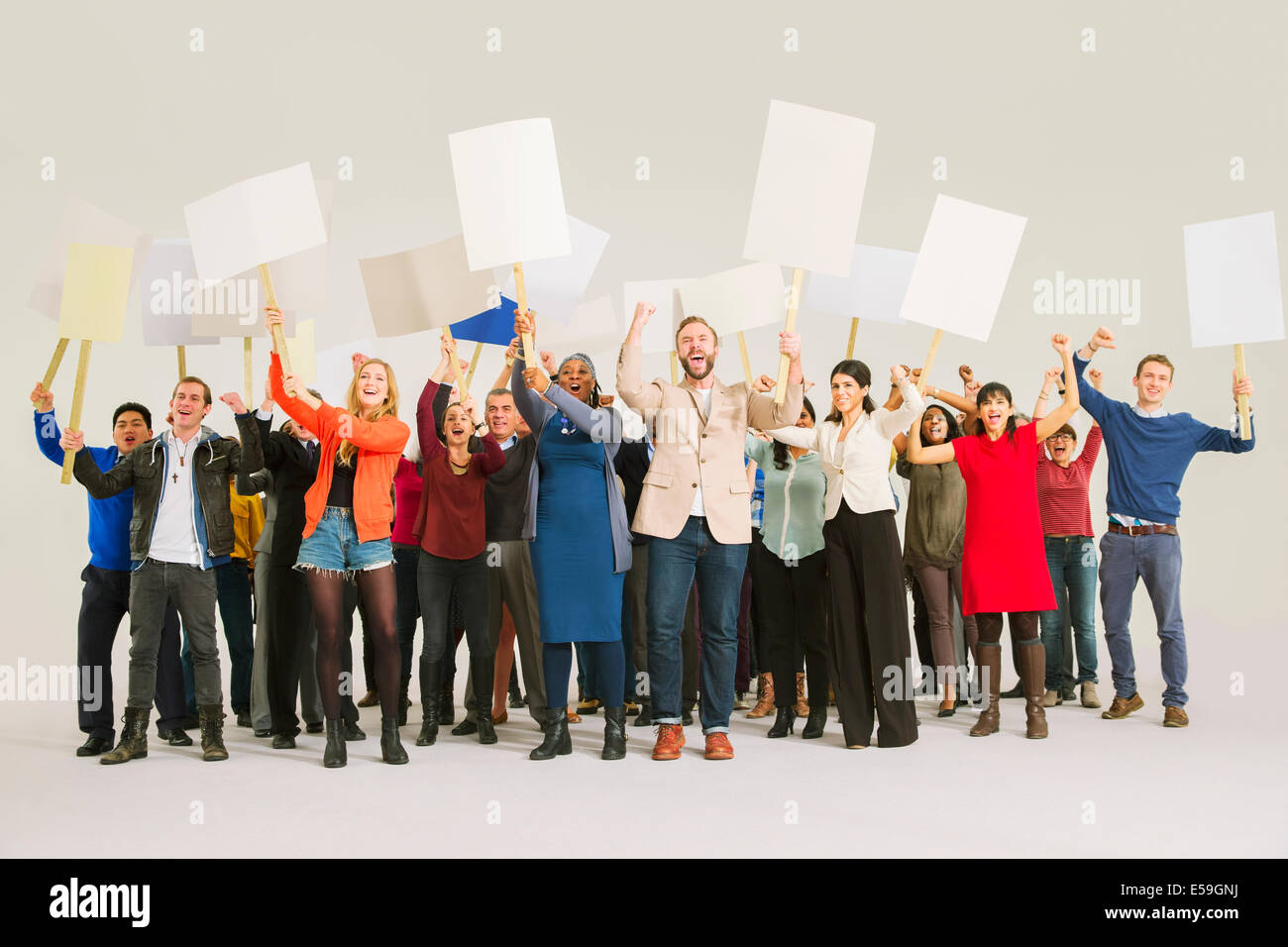 Diverse crowd with picket signs - Stock Image