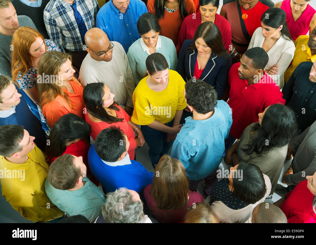 Business people standing face to face - Stock Image