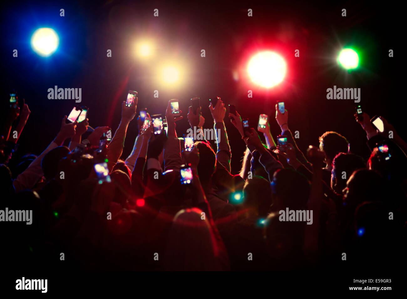 Audience using camera phones at concert Stock Photo