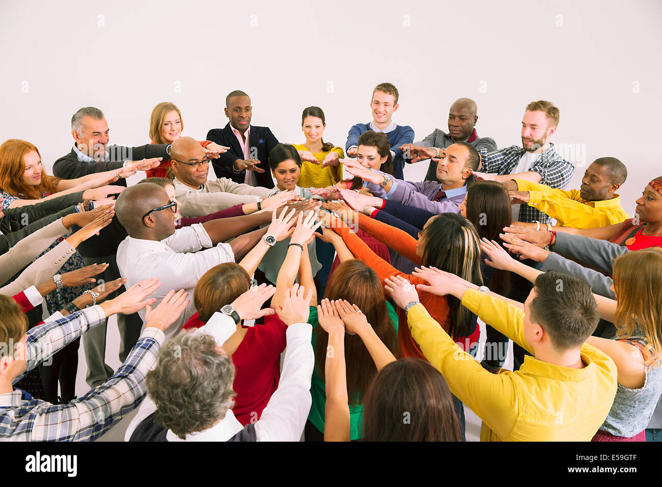 Business people connecting hands in huddle - Stock Image