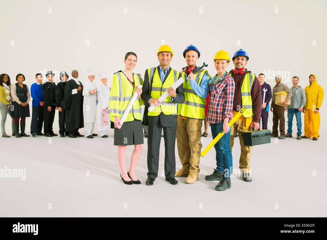 Portrait of confident construction workers - Stock Image