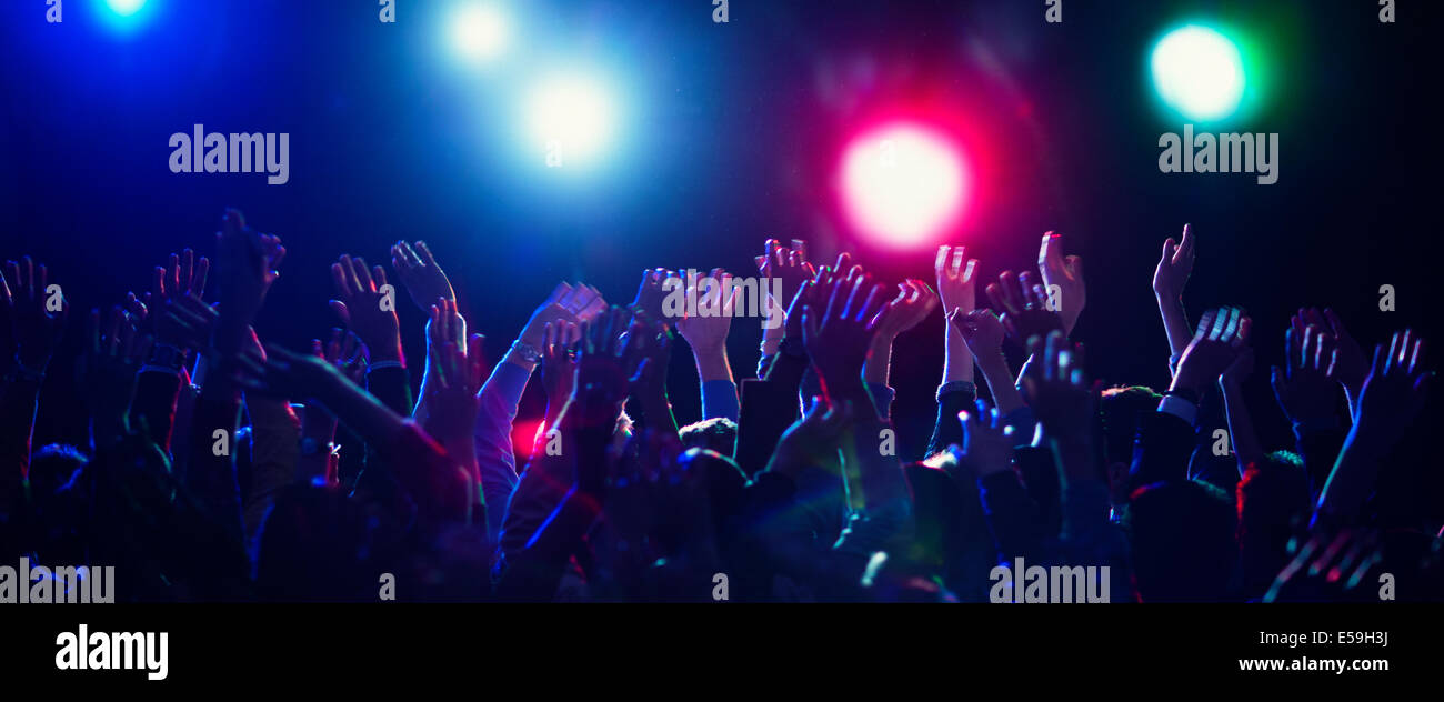 Crowd cheering at concert - Stock Image