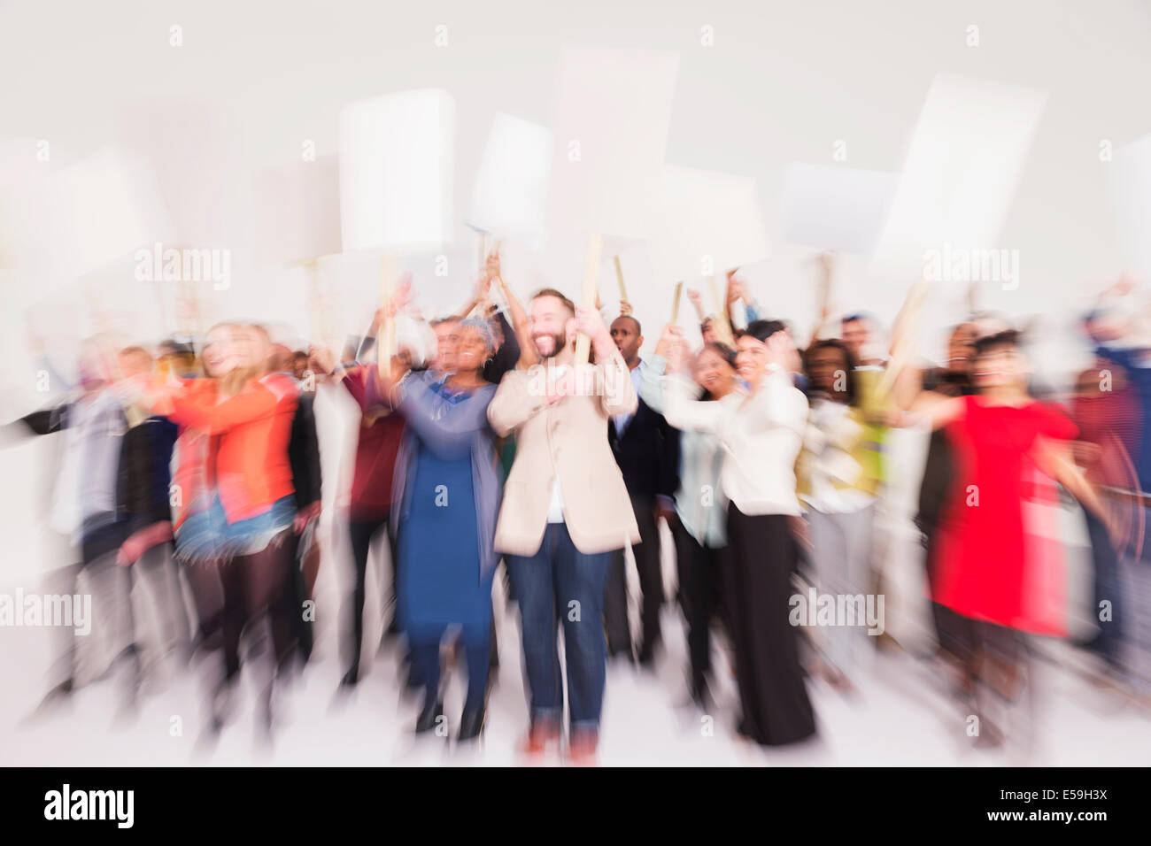 Protesters waving picket signs - Stock Image