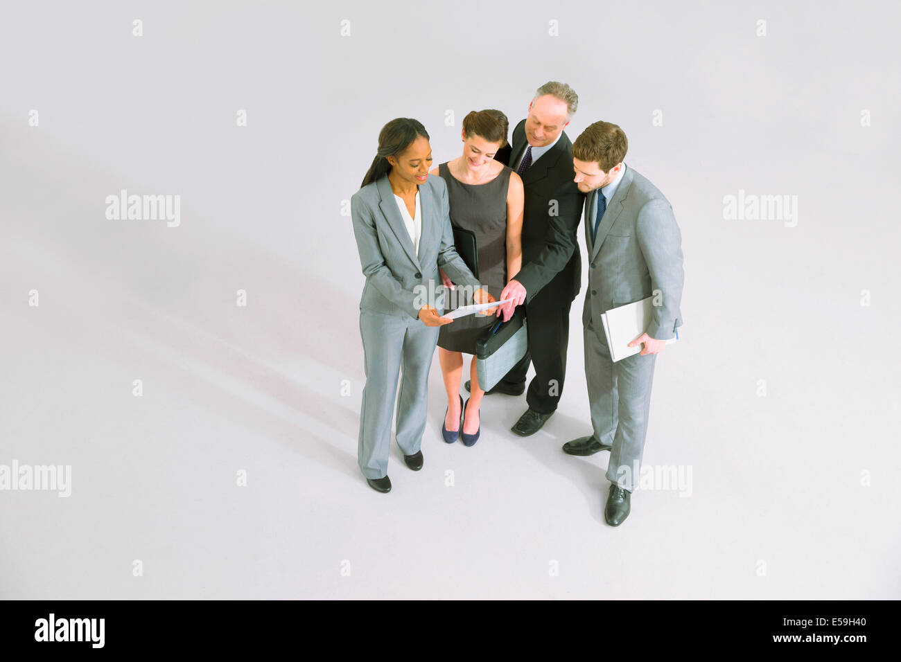 Business people reviewing paperwork - Stock Image