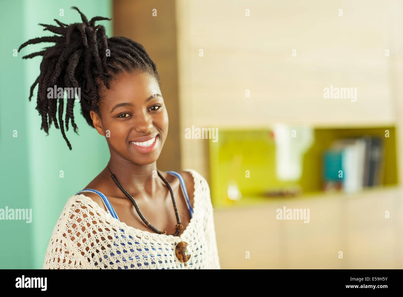 Woman smiling in office - Stock Image