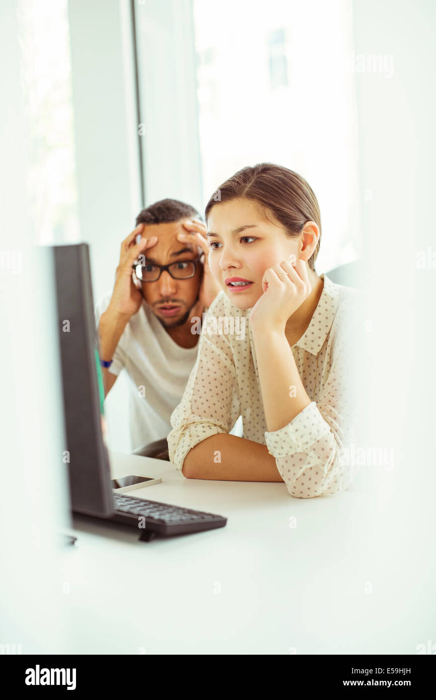 People working on computer in office - Stock Image
