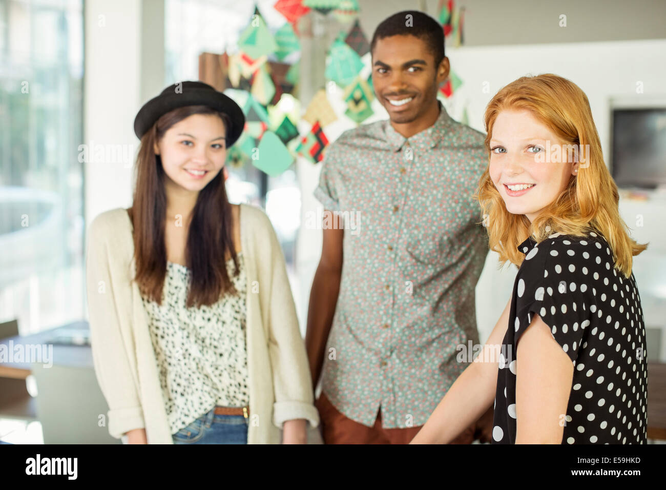 People smiling in office - Stock Image